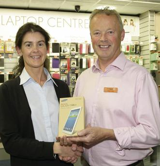 Competition winner Susan Crosbie from Foulksmills being presented with a Samsung Galaxy Tab 3 by Derek Joyce at the Joyce's Technology Evening