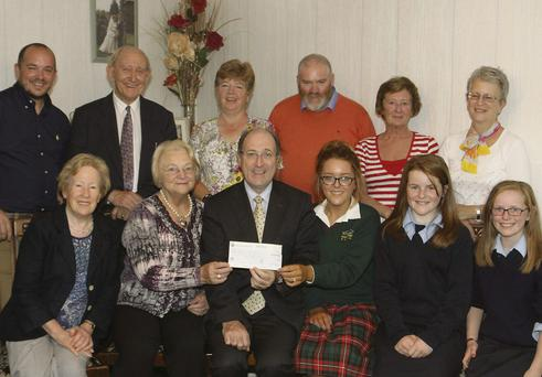 At the presentation of a cheque for €3,140 for the new cancer unit at Crumlin Hospital were (front) Gay Lambert, Martha Leathem (fundraising manager Crumlin Hospital), Gerry Cully, Emma, Aoife and Ciara Sweeney. (Back) Jamie Conway, Kevin McLoughlin, Kay O'Rourke, Kevin Conroy, Mary Murphy and Joan Stone