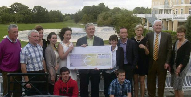 Pat Kenny receiving the cheque
