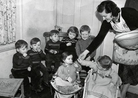 An inconic photograph of Maureen Coughlan Cavanagh Byrne from the early 1950s with l-r back, triplets Christy, Martin and Paddy; their older sister Sinead; their eldest brother Sean; and in front, the twins Maureen and Eamonn.
