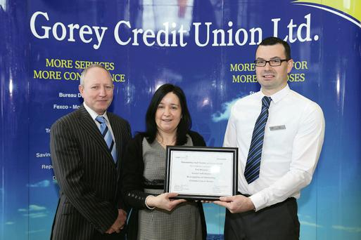 Tom Brennan, Gorey Credit Union, receiving his award from business development manager at Ulster bank, Paula Carroll, and Credit Union manager, Pat Derwin (left).