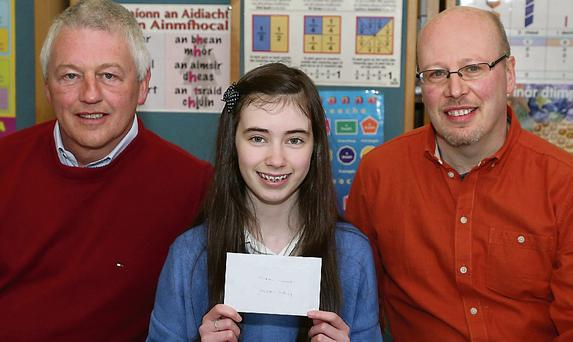 Kieran Cullen, Wexford Mental Health Association, presents Megan Hurley with her prize. Also pictured is her teacher, Fionntan O'Suilleabhain.