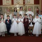 The Ballyduff NS Communion class pictured on their special day recently. Front (from left) Emer Dreelan, Kayla Browne, Megan Hayes, Elese Doyle, Adam Roche, Kate Murphy, Niamh Ryan, Davy Redmond, Sean McGrath, Kalleigh Ann Redmond, Conor Breen, and Alanna Devereux. Back: Fr. Redmond; Ms Murphy, class teacher; P. Sadlier, principal; and Fr. Cushen