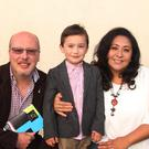 Cllr Fionntán Ó Súilleabháin, Alejandra Uí Súilleabháin of the ICA community tapestry group and their son Emiliano Fionntán at at the Gap Arts Festival in Ballymoney