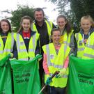 Underage members of Buffers Alley GAA club, supervised by Joe Doyle, participating in the club clean up day, as part of the Wexford Co. Council 2K road clean up initiative