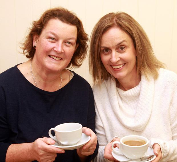 Enjoying a cuppa at the coffee morning at Gorey Property Lettings offices in aid of St. Aidan 's Day Care Centre were Catherine Gregan from St. Aidan's Services and Paula Gleeson