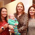 Sue Longmore, Rionagh Ryan with her baby son Cuan and Gráinne Deacon at the coffee morning at Gorey Property Lettings offices in aid of St Aidan's Day Care Centre