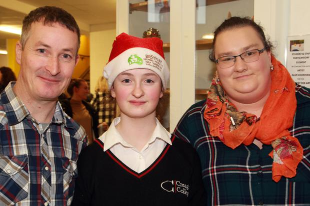 Felix and Siobhan Byrne with their daughter Mia at the Creagh College Christmas carol service