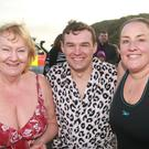 Annette Ward, Michael Higgins and Jenny O'Loughlin at the New Year's Day swim in Cahore