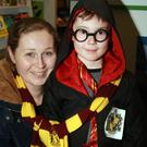 Mary Andrews with her son, Jamie Clyne enjoying the Harry Potter book night in Gorey Library
