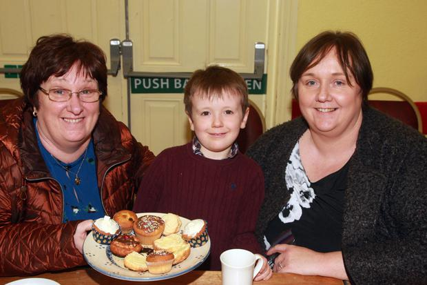 Deirdre Dalton, Iwan Marks with his mother, Ann Marks at the coffee morning and cake sale at Craanford community hall in aid of the fundraising effort of Gorey Community School volunteer, Blathnaid Kenny for the Lourdes Pilgrimage Trust