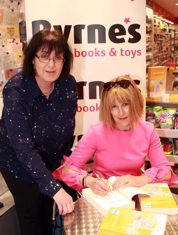 Eleanor O'Reilly signing a copy of her book, 'M is for Mammy' for Ruth Shern in Byrne's bookshop, Gorey