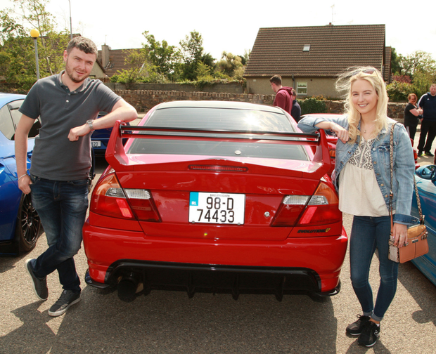 Alan Ferris beside his Mitsubishi Lancer Evo, with Amy Fitzpatrick at the Darragh D'Arcy memorial drive in aid of Pieta House and CMRF Crumlin