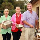 Sheila O'Sullivan, Michelle O'Byrne and Craig Ashmore Butler looking after the food at the annual barbecue at Middletown House nursing home