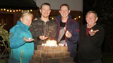 Declan and Ann Darby with their sons, Colin and Neil taking part in the 'Shine your Light' event recently to honour everyone battling the Covid-19 pandemic, those who have died, loved ones, frontline staff and healthcare workers
