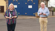 Rose Murphy, RNLI shop manager, and Sam Kennedy, Operation Manager, with the medals they received to mark 30 years of service to Courtown RNLI