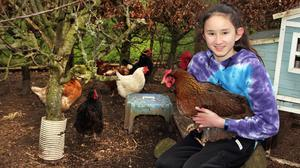 Alia Murphy with some of her pet hens
