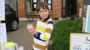 Scott Cullen at his lemonade stand outside his house in Gorey