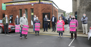Protesting publicans delivering a letter to Minister James Browne outside his office in Enniscorthy yesterday (Monday) morning