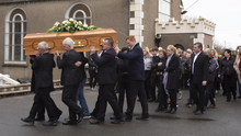 The funeral procession arrives at Kilmore Church