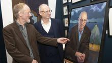 Artist Tony Robinson and Billy Roche with the portrait of Billy unveiled at Wexford Arts Centre