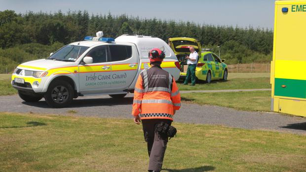 Emergency services at Riverchapel Community Field where the man was airlifted to hospital in Dublin