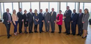 Members of the executive and board of the IDA, accompanied by senior staff of the county council