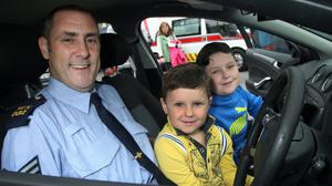 Sgt Kevin Bolger pictured during an open day at Gorey Garda Station with Ryan and TJ Morrissey
