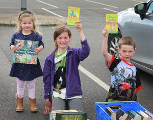 Caoimhe, Niamh and Padraic Owens at the Gorey Youth Needs book exchange
