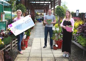 Eimear Mannion, CEO of St Aidan's Services, receives a cheque for €3,500 – the proceeds of the Oakhill residents walk, run and cycle relay – from relay organisers Darren Burke and Katie Quinlan at St Aidan's Garden Centre