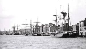 A busy day in Wexford Harbour in this picture from the late 1800s, with at least 13 sailing vessels and a steam-ship alongside. National Library of Ireland