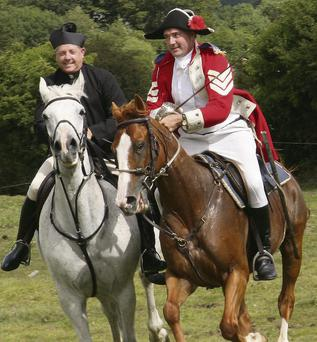 Re-Enactment Vinegar Hill Sunday Afternoon,Fr. Murphy chases a redcoat Cavalary soldier from the battle.