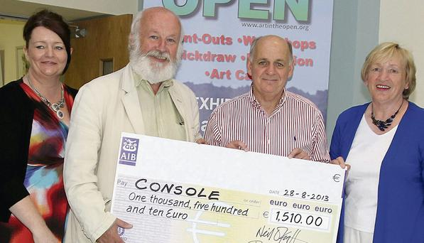 At the presentation of a cheque by Art in the Open to Console in The Presentation Centre were Mairead Lineen (centre manager), Neil O'Keeffe (organisor Art in the Open), Denis O'Connor (Console) and Rita Lett (consultant with Console).