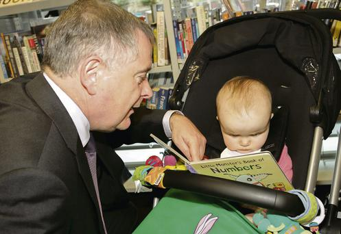 Minister Brendan Howlin with Chloe Cooper at the launch of 'Books4Babies' at Wexford Library.