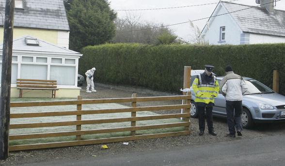 Gardai outside the Courtown home of the late John Lawlor on Christmas Day.