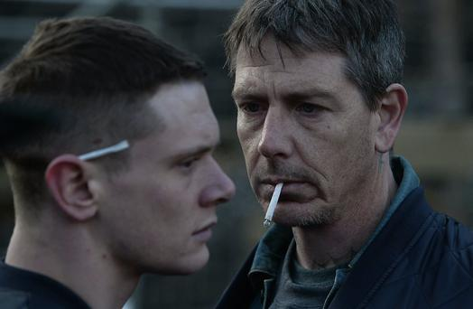 Jack O'Connell as Eric and Ben Mendelsohn as Neville in Starred Up.