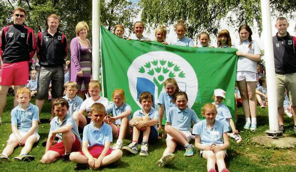 Group pictured at the raising of the fourth Green Flag at Our Lady of Lourdes National School.