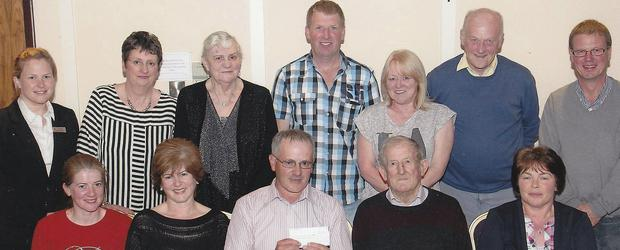 At the cheque presentation were (Back, from left) Joy Rothwell (Riverside Park Hotel), Bridget Mulligan, Cathy O'Gorman, Christy Whelan, Mona Davitt, Tom Doran and Bernard Doran. (Front, from left) Margo Meyler, Patsy Kelly, Mick Wickham, James O'Gorman and Audrey French