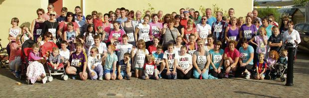 Some of the more than 250 people who took part in the 5k walk and run in Camolin in memory of the late Donal Byrne