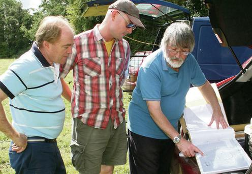 Mark Hewlett, Graham Cadogan and Kevin Barton looking at some of the site maps in Kilmokea Gardens