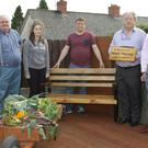John White, Cllr. Robbie Ireton, Aoife, Gordan and Thomas Moules (father of the late, Niall Moules) and chairman Gorey Men's Shed, Gerry McParland at unveiling of bench in memory of Niall Moules