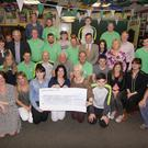 The Naomh Eanna cyclists, friends and supporters present cheques worth €43,600 to the Naomh Eanna fund and five cancer charities.
