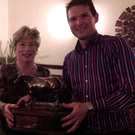 Nola Farrell presenting the trophy to winner Ed Whelan at the second Cock and Bull Story competition night