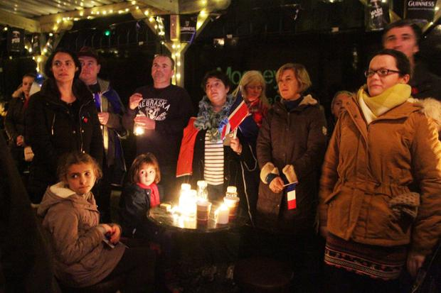 Some of those who gathered at the candlelight vigil