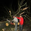 James Bradley and Shane Breen help clear the obstructions at Solsboro, outside Enniscorthy