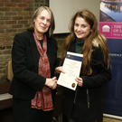 Bridget receiving her 'certificate of participation' from the Chief Justice Mrs Justice Susan Denham