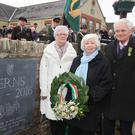 Bernadette Moulds, Mary Ffrench, and Martin Dunbar lay a wreath at the new plaque