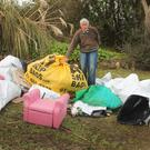 Eric Farley is hoping people might recognise the items dumped illegally on his land at Ardamine, so those responsible can be tracked down and prosecuted