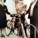James Gleeson (centre) with the bike he used to travel from Gorey to Ennsicorthy to take part in the Rising in the town in 1916