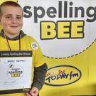 Harry Dempsey with his Eason Spelling Bee certificate